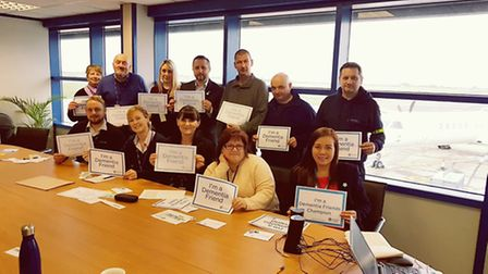 Staff at Norwich Airport are given dementia training by Age UK Norwich's Marie Lucas (front right).