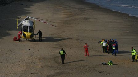 Emergency services at the scene after a man was injured near Southwold. Pictures: HM COASTGUARD LOWE