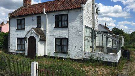 White Cottage in Saxlingham. as it was before the renovation which has transformed the property. Pho