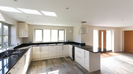 Open plan kitchen space in White Cottage in Saxlingham. Photo: Courtesy of Brooks Residential