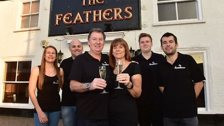 Julie and Terry Earing (centre) celebrating becoming the new landlords of the Feathers pub in Gorles