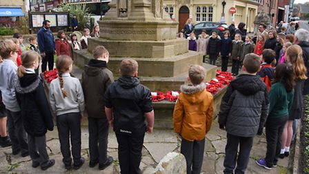 Belfry Primary School children at the Cromer War Memorial to commemorate local soldiers who fell at
