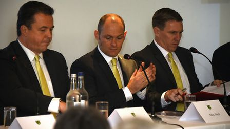 And then there was one - Alex Neil flanked by former chief executive Jez Moxey, left, and technical