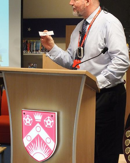 The fifth Lowestoft primary schools spelling bee contest. Tony Bown, ODA vice principal, and spellin