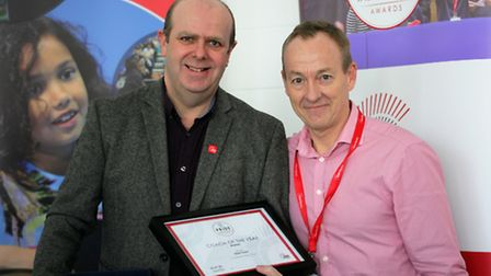 Mark Dare receives his coaching award from England coach Alan Cooke. Picture: Melvyn Lovegrove.