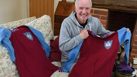Ronnie Boyce who played with West Ham and now lives in Great Ryburgh, with two of his shirts. He hol