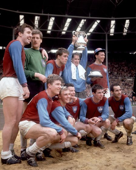 West Ham United celebrate with the FA Cup after their 3-2 victory: (back row, l-r) John Bond, Jim St