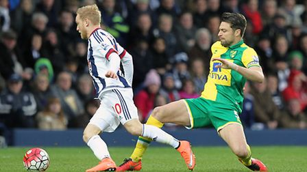 Russell Martin defends against on-loan West Bromwich Albion forward Alex Pritchard, during Norwich C