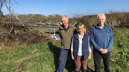 From left, Steve Land, Catherine Fraser and David Fraser, by the knocked-down telephone pole by Norw