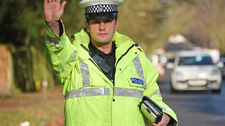 Norfolk Police stopping drivers using mobile phones along Unthank Road. PC Martin Goulder. Picture: