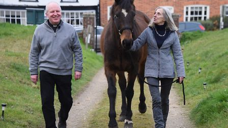Rev Alan Perry meets Marion Tilney and Basil arriving for the Wangford Pet Service. Picture: DENISE