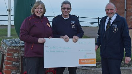 Felicity Christian of Sainsbury's North Walsham and Dave Banks presenting a cheque for �200 to Munde