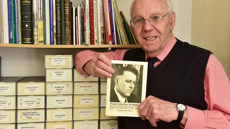 Local historian John Holmes, who died in February, pictured with his book about sailor Victor Crisp.