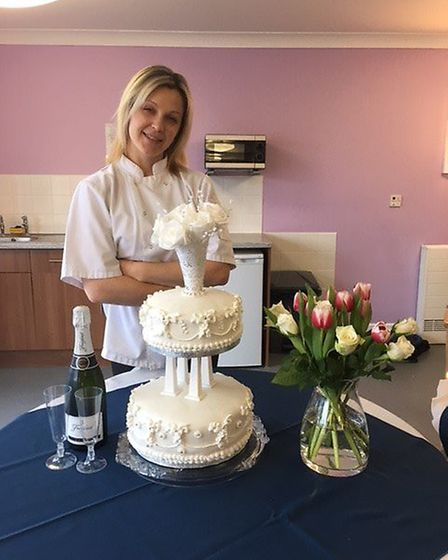 Jelena Morozova with the cake. Picture: Peter Barlow