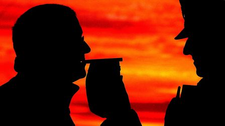 A motorist stopped by police taking a breath test. Picture: John Giles/PA Wire.