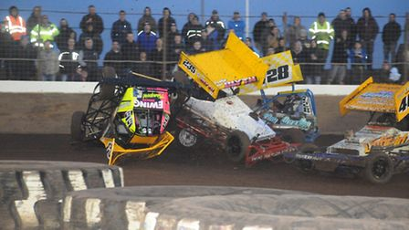 Courtney Finnikin and Wisbech racer Bradley Blyth in the thick of the action at King's Lynn. Picture
