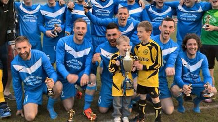 Liam Walsh and Ryan Walsh with fellow Runton FC players. Picture: ANDREAS YIASIMI