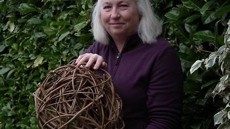 Adele Goodchild with one of the sculptures created for the new wildlife art trail at Ivy Grange Farm