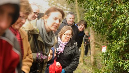 Crowds watch as the duck race at Wymondham comes to the finish line. Photograph Simon Parker