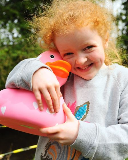 The annual Wymondham Duck Race. Keola Siver, from Wicklewood, hugs an extra duck at the race. Pictur