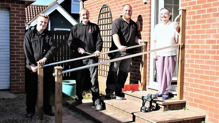 Volunteers, from left, Connor, Gary and Jamie of Ben's Workforce, with Trixie Fenn, admiring the new