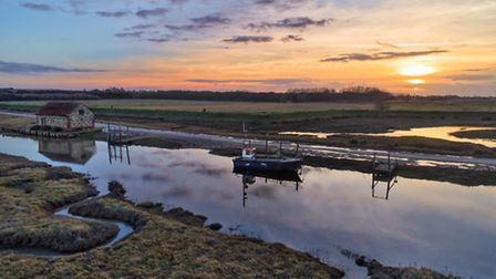 The old coal barn and boats at Thornham