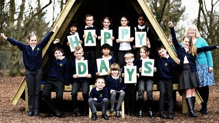 Ashwicken Primary School has been rated good by Ofsted. Pictured with pupils at the school is headte
