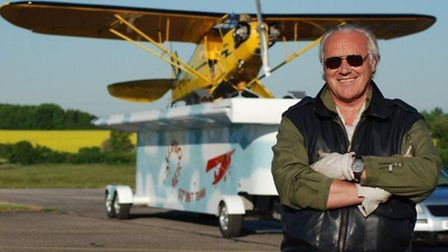 Pilot Brendan O'Brien with his Piper J3 Cub plane which he will land on the back of a moving trailer