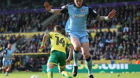 Wes Hoolahan of Norwich turns Greg Halford of Rotherham United on the way to opening the scoring dur