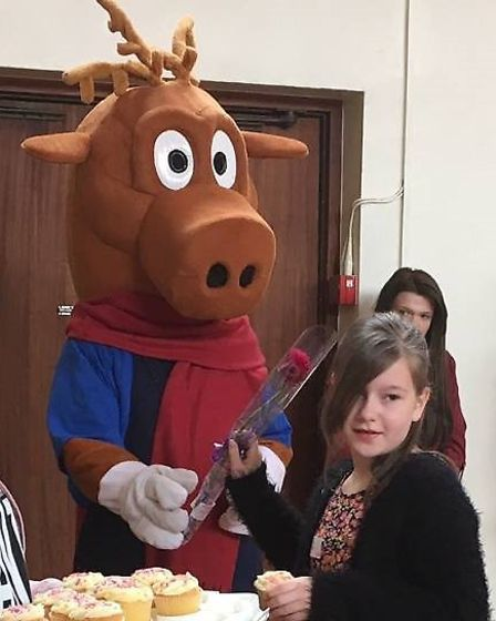 Isobel Hammond will be an attendant for Dereham Carnival. She is pictured accepting a cupcake and f