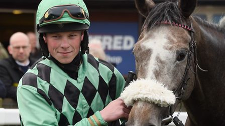 Jockey Conor Shoemark with Hint of Grey after they won the Robert Case Memorial Conditional Jockey's