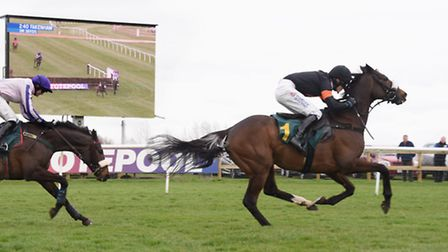 Master Jake, out in front and goes on to win the Easter Monday Racing Novices' Handicap Steeple Chas