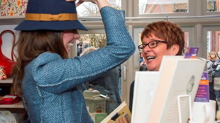 The Duchess of Cambridge tries on a Boden hat at EACH shop in Holt: Picture: Arthur Edwards