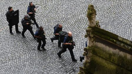 Armed police at the scene outside the Palace of Westminster, London, after policeman has been stabbe