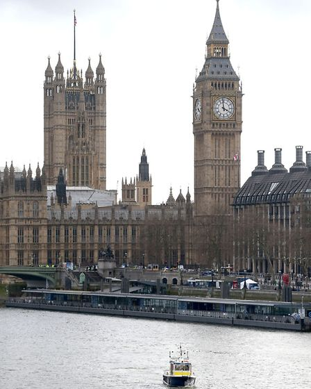 A police river boat on the River Thames at the Houses of Parliament, after a policeman was stabbed a