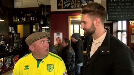 Jake Watson talks to an NCFC fan at The Ribs of Beef. Photo from Mustard TV.