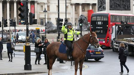 Mounted police in Trafalgar Square, London, after policeman has been stabbed and his apparent attack
