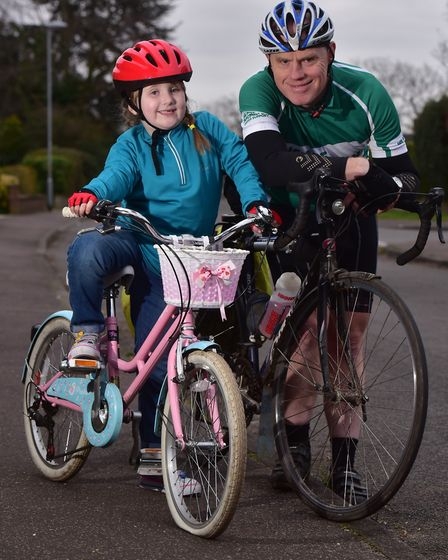 Peter Busssey and his granddaughter Georgia,6, are planning a 50 mile charity cycle trip from the Ho