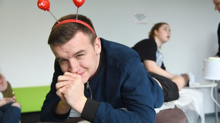 College of West Anglia student Morgan Barker having his legs waxed on Red Nose Day. Picture: Ian Bur