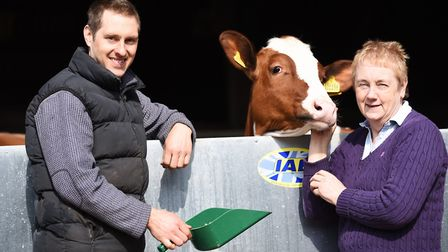 Former dairy farmers Ava Barrell and her son Tim with one of the few remaining calves from the famil