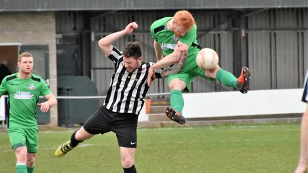 Jacob Short in an aerial battle for Gorleston against Long Melford. Picture: David Hardy