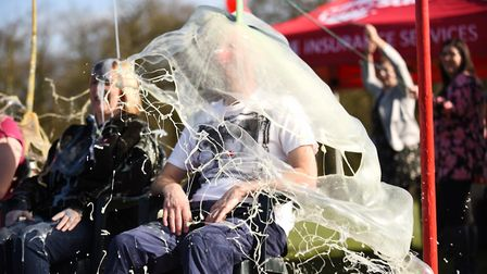 Staff at Adrian Flux Insurance raised over £10,000 for Comic Relief by gunging their bosses. Picture