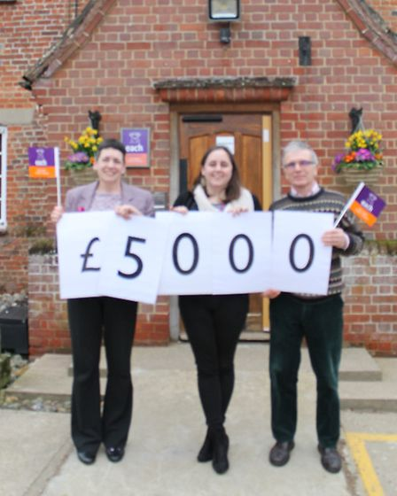 Paul and Helen Hudson with Madeleine Dodsworth from the Each fundraising team celebrate raising �500