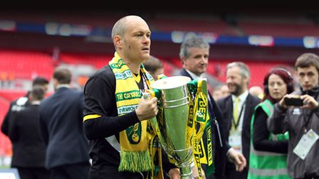 Former Norwich City manager Alex Neil holds the Championship play-off trophy aloft at Wembley in 201