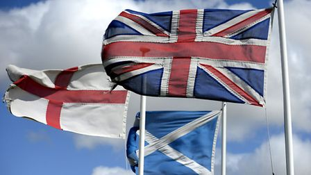The Flags of St George, the flag of Scotland and the Great Britain flag fly high in North Northumbe