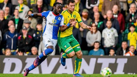 Marvin Emnes tussles with Yanic Wildschut in a rare moment of high energy for Blackburn at Carrow Ro