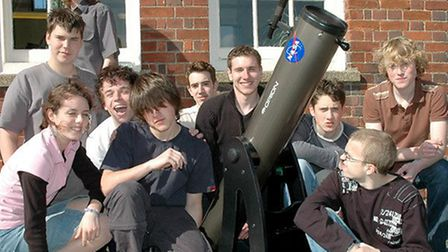 Members of Dereham Sixth Form College's astronomy club in 2005 with a telescope paid for by NASA. Te