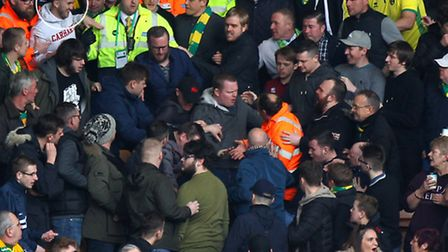 1. Tempers flare as stewards and police move in to remove fan, Jamie Wells (circled), during the Sky