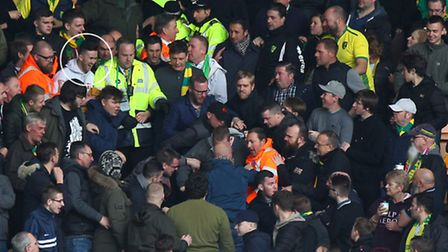 2. Wells appearing to laugh as he is led away by stewards. Picture by Paul Chesterton/Focus Images L