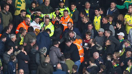 4. Security staff help stewards lead Wells (circled) away. Picture by Paul Chesterton/Focus Images L